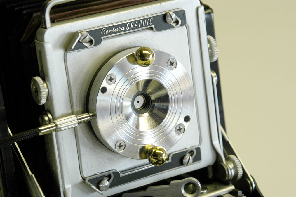 Christiansen's Apo II shutter is made from titanium, brass, and Garolite, and is cable-release activated. Pinholes and zoneplates of varying dimension may be swapped in and out depending on focal length.