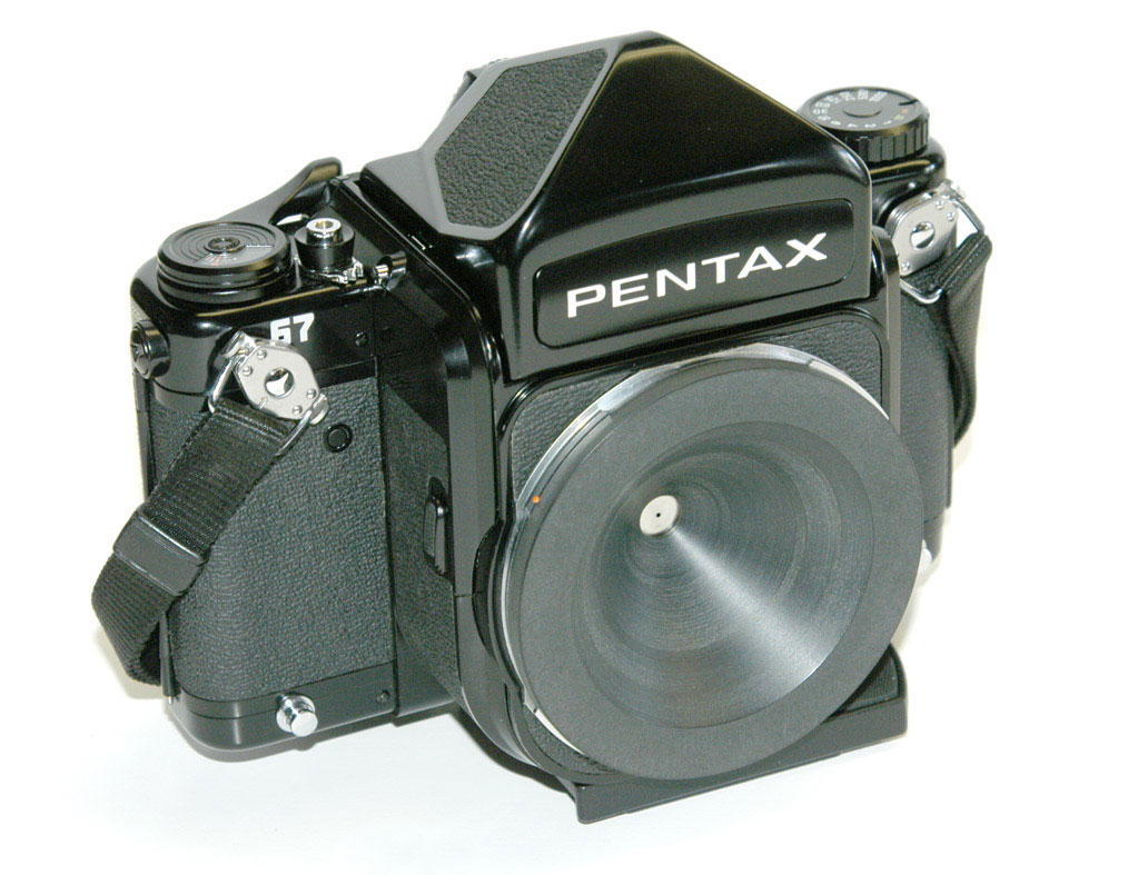 A custom pinhole bodycap for a Pentax 67.